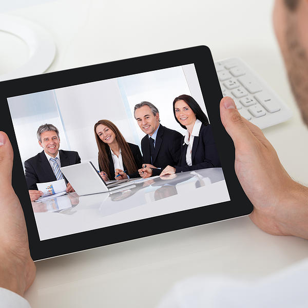 Businessman Videoconferencing With Digital Tablet